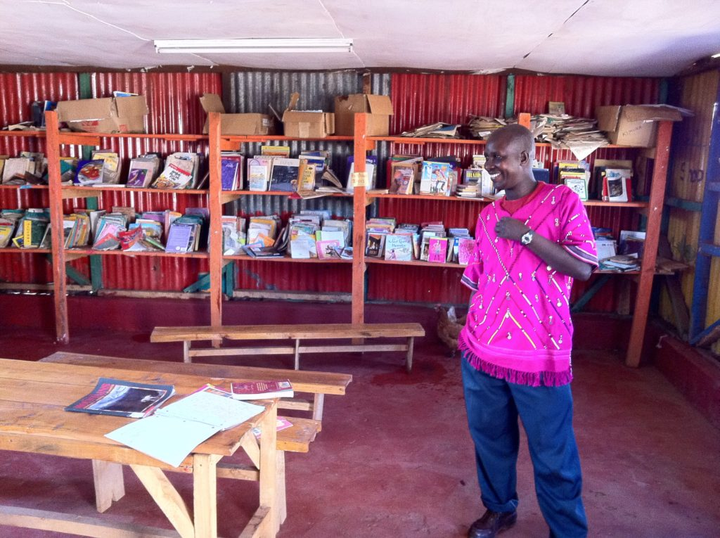 Chief Joseph Ole Tipanko in one of his community's libraries, built with donations.